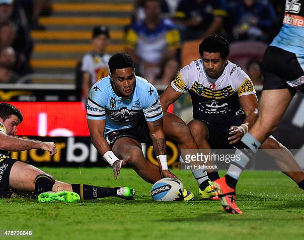 Ricky Leutele of the Sharks scores the winning try during the round 16 NRL match between the North Queensland Cowboys and the Cronulla Sharks at...