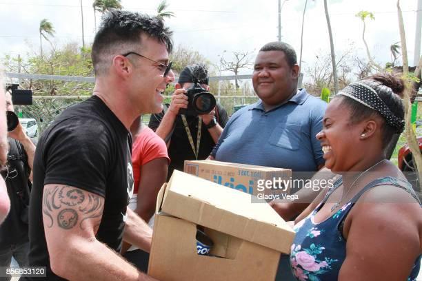 Ricky Martin delivers aid to victims of Hurrivcane Maria at the Loiza community on October 2 2017 in Loiza Puerto Rico