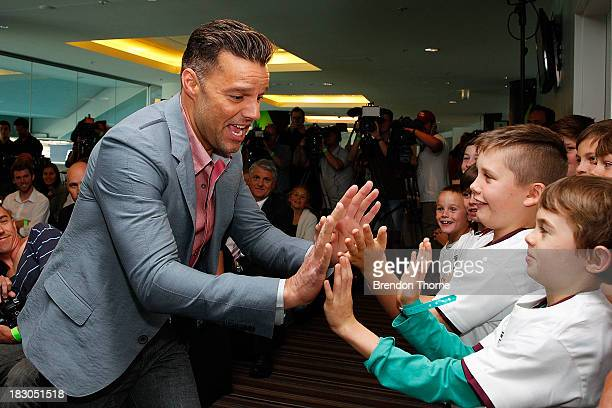 Ricky Martin greets children during an entertainment media conference at ANZ Stadium on October 4 2013 in Sydney Australia The Sydney Roosters play...