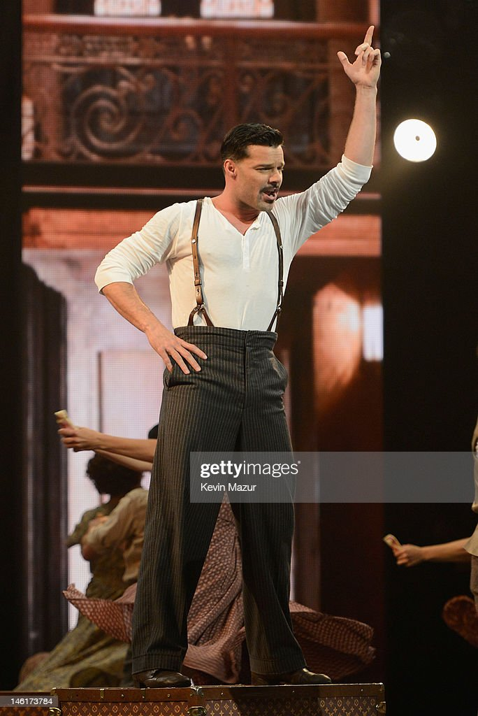 <a gi-track='captionPersonalityLinkClicked' href=/galleries/search?phrase=Ricky+Martin&family=editorial&specificpeople=160450 ng-click='$event.stopPropagation()'>Ricky Martin</a> performs from 'Evita' onstage at the 66th Annual Tony Awards at The Beacon Theatre on June 10, 2012 in New York City.