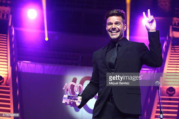 Ricky Martin poses on stage with his 'Cadena 100 Number 1 awards 2014' at the Mnac Museu d'Art de Catalunya on May 28 2015 in Barcelona Spain