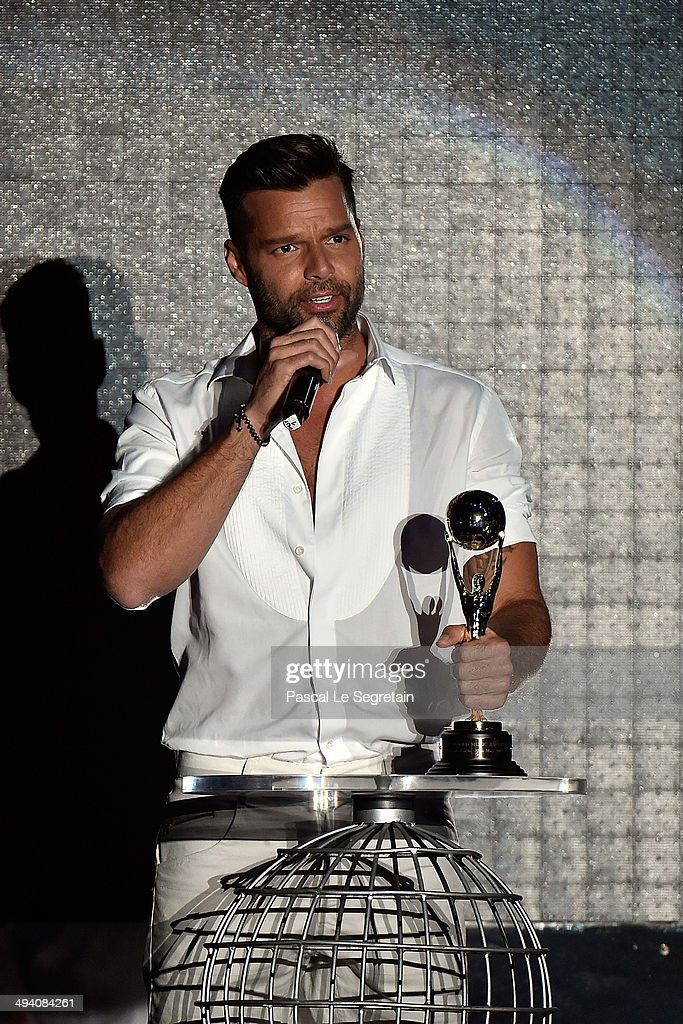 <a gi-track='captionPersonalityLinkClicked' href=/galleries/search?phrase=Ricky+Martin&family=editorial&specificpeople=160450 ng-click='$event.stopPropagation()'>Ricky Martin</a> receives a award during the ceremony of the World Music Awards 2014 at Sporting Monte-Carlo on May 27, 2014 in Monte-Carlo, Monaco.