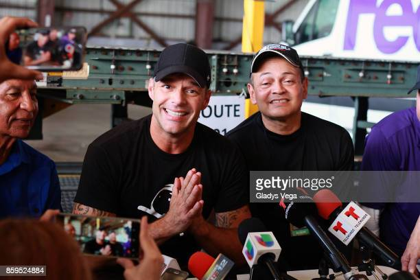 Ricky Martin with Mayor of Aguadilla Carlos Mendez and Mayor of Anasco Jorge Estevez speak to the media after Ricky Martin's arrival on a FedEx plane...