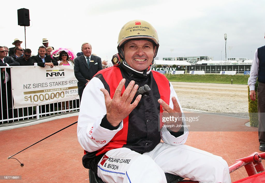 Ricky May, the driver of Terror to Love, winner of the New Zealand Trotting Cup, holds up 7 fingers representing 7 New Zealand Cup wins during New Zealand Trotting Cup Day at Addington Raceway on November 12, 2013 in Christchurch, New Zealand.