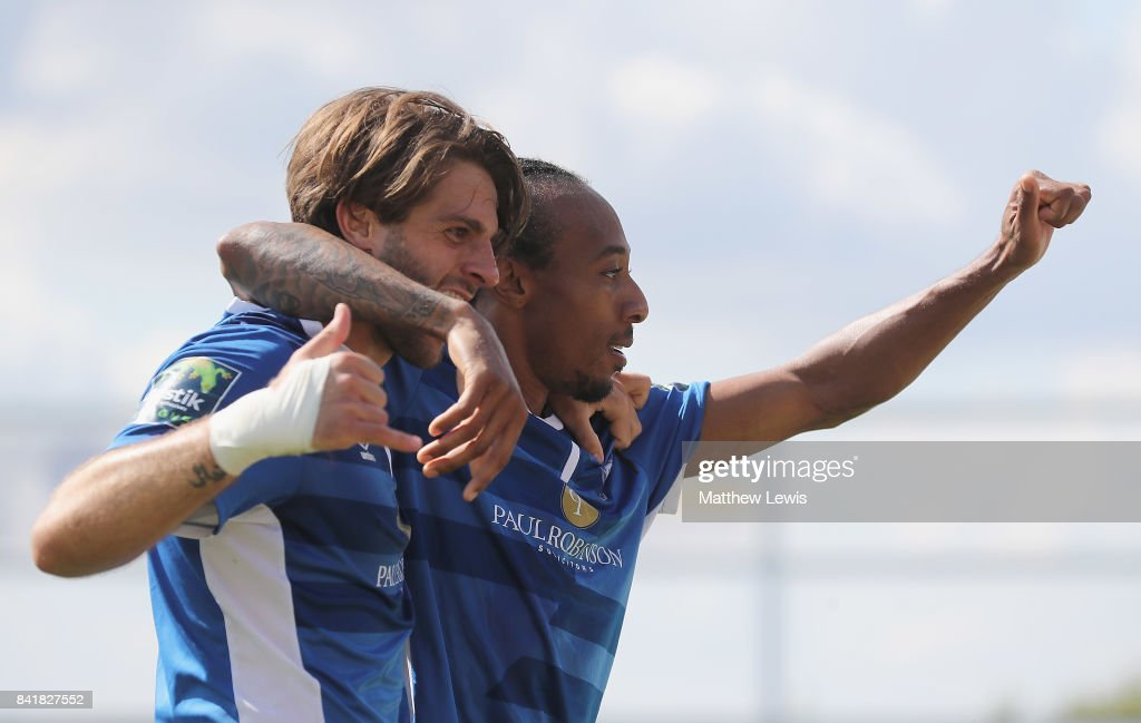 Ricky Modest of Billericay Town is congratulated on his goal by Joshua Urquhart of Billericay Town during The Emirates FA Cup Qualifying First Round match between Billericay Town and Didcot Town on September 2, 2017 in Billericay, England.