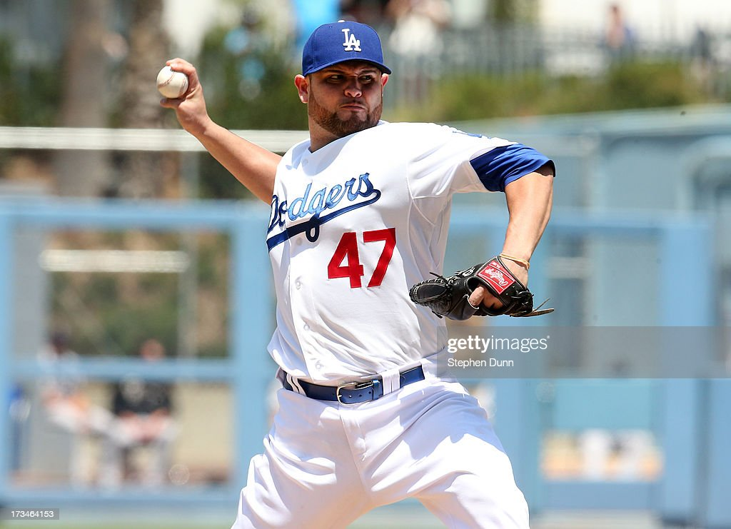 <a gi-track='captionPersonalityLinkClicked' href=/galleries/search?phrase=Ricky+Nolasco&family=editorial&specificpeople=600111 ng-click='$event.stopPropagation()'>Ricky Nolasco</a> #47 of the Los Angeles Dodgers throws a pitch against the Colorado Rockies at Dodger Stadium on July 14, 2013 in Los Angeles, California.