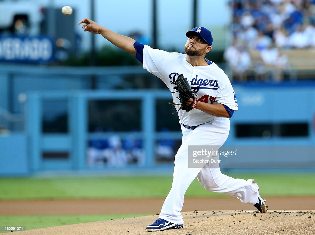 <a gi-track='captionPersonalityLinkClicked' href=/galleries/search?phrase=Ricky+Nolasco&family=editorial&specificpeople=600111 ng-click='$event.stopPropagation()'>Ricky Nolasco</a> #47 of the Los Angeles Dodgers throws a pitch against the San Francisco Giants at Dodger Stadium on September 14, 2013 in Los Angeles, California.