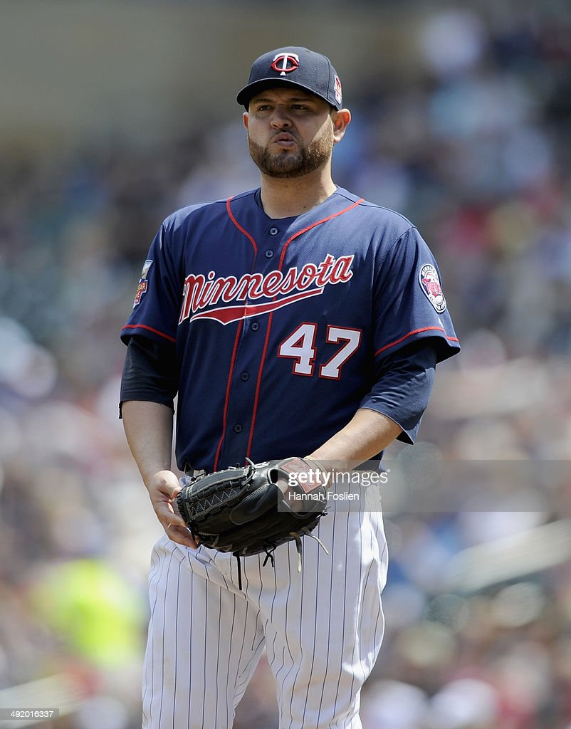<a gi-track='captionPersonalityLinkClicked' href=/galleries/search?phrase=Ricky+Nolasco&family=editorial&specificpeople=600111 ng-click='$event.stopPropagation()'>Ricky Nolasco</a> #47 of the Minnesota Twins reacts during the fifth inning of the game against the Seattle Mariners on May 18, 2014 at Target Field in Minneapolis, Minnesota. The Mariners defeated the Twins 6-2.