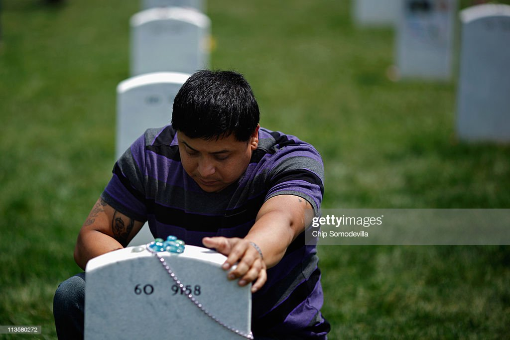 Ricky Parada of Stafford, Virginia, visits the grave of his brother, U.S. Marine Corporal Nicholas Parada Rodriguez, at Arlington National Cemetery May 3, 2011 in Arlington, Virginia. After hearing the news about the death of Osama Bin Laden, Ricky Parada thought of his brother said to himself, 'Man, I've got to go and talk to him.' Parada Rodriguez was killed May 16, 2010 during the Marja offensive in Afghanistan. It was his third combat tour and second tour of Afghanistan.
