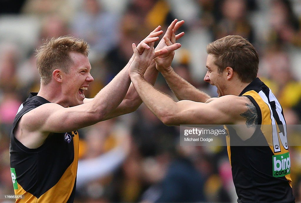 Ricky Petterd (R) and <a gi-track='captionPersonalityLinkClicked' href=/galleries/search?phrase=Jack+Riewoldt&family=editorial&specificpeople=2327975 ng-click='$event.stopPropagation()'>Jack Riewoldt</a> of the Tigers celebrate goal during the round 21 AFL match between the Richmond Tigers and the Carlton Blues at Melbourne Cricket Ground on August 17, 2013 in Melbourne, Australia.