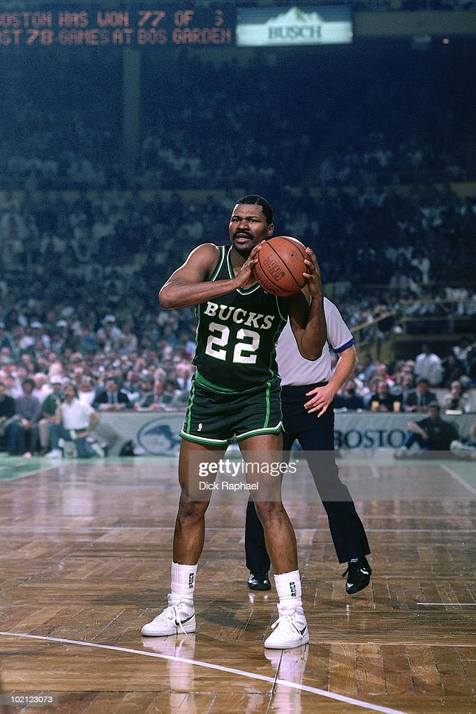 Ricky Pierce #22 of the Milwaukee Bucks passes against the Boston Celtics during a game played in 1987 at the Boston Garden in Boston, Massachusetts.
