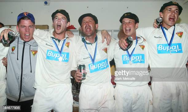 Ricky Ponting and his Tigers teammates players celebrate in the changing rooms after winning the Sheffield Shield final between the Tasmania Tigers...