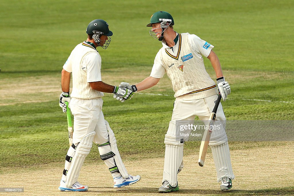 Ricky Ponting and Jordan Silk of Tasmania shake hands after a century partnership during day four of the Sheffield Shield match between the Tasmania Tigers and the Victoria Bushrangers at Blundstone Arena on March 17, 2013 in Hobart, Australia.