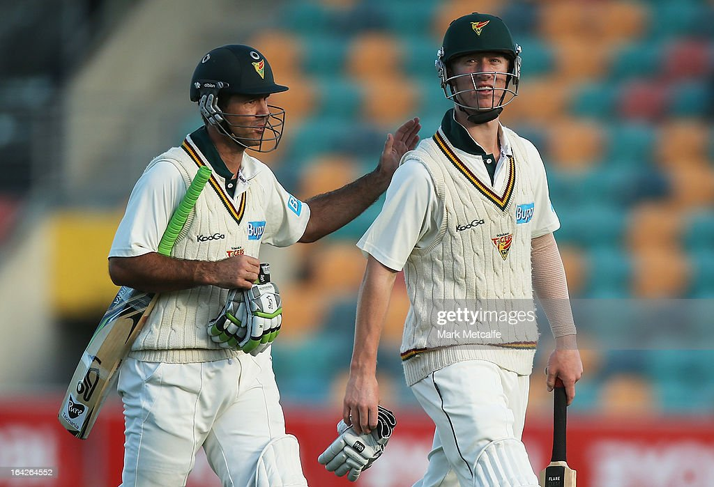 Ricky Ponting and Jordan Silk of the Tigers leave the field at the end of play on day one of the Sheffield Shield final between the Tasmania Tigers and the Queensland Bulls at Blundstone Arena on March 22, 2013 in Hobart, Australia.