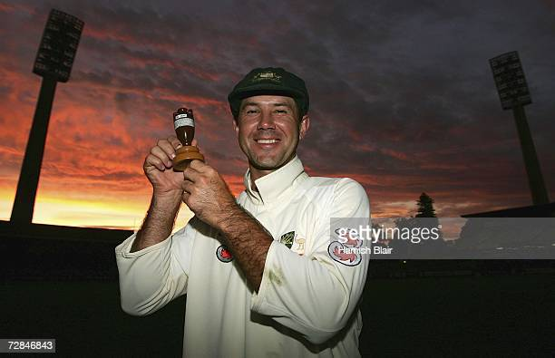 Ricky Ponting captain of Australia poses with a replica Ashes Urn out on the pitch of the WACA at sunset as Australia celebrates regaining the Ashes...