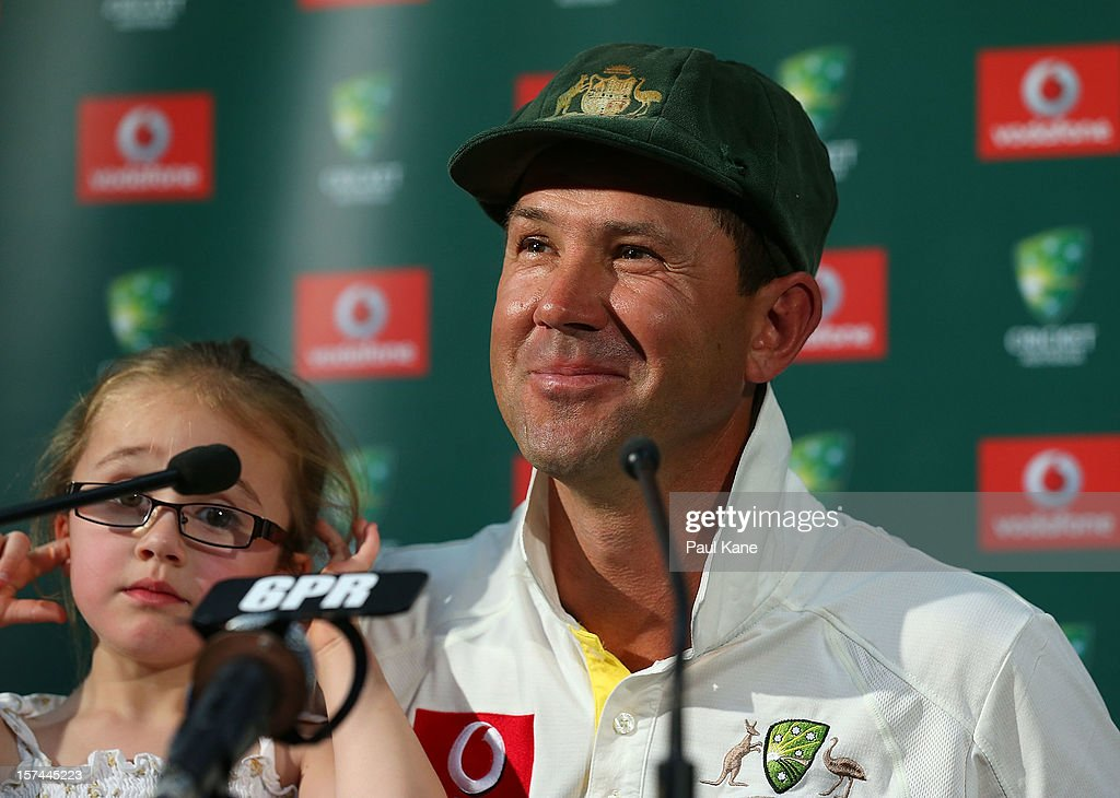 Ricky Ponting of Australia addresses a media conference with his daughter Emmy after playing his last International cricket match during day four of the Third Test Match between Australia and South Africa at WACA on December 3, 2012 in Perth, Australia.
