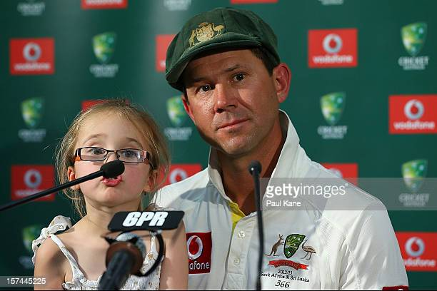 Ricky Ponting of Australia addresses a media conference with his daughter Emmy after playing his last International cricket match during day four of...