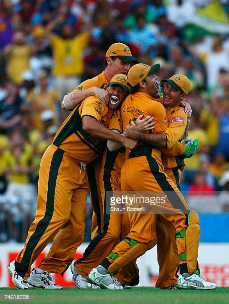 Ricky Ponting of Australia celebrates the wicket of Chamara Silva of Sri Lanka with team mates Adam Gilchrist and Andrew Symonds during the ICC...