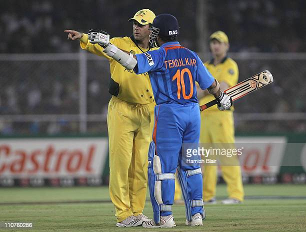 Ricky Ponting of Australia chats with Sachin Tendulkar of India about a sight problem behind the bowler's arm during the 2011 ICC World Cup Quarter...