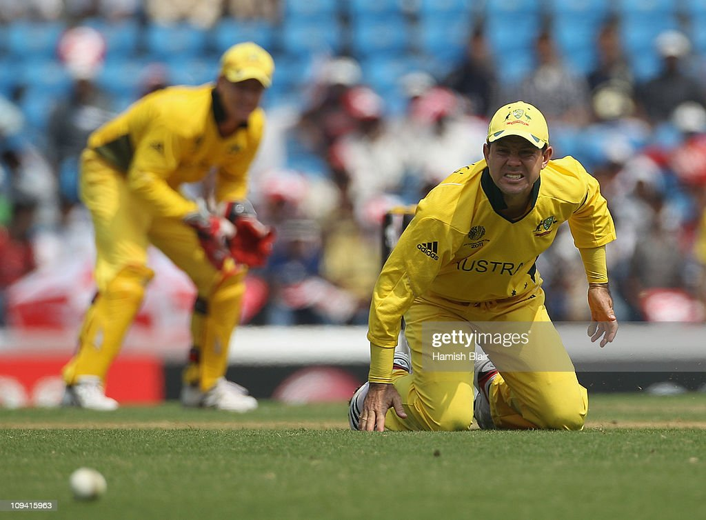 Ricky Ponting of Australia grimaces after being struck on his injured finger by a drive from Nathan McCullum of New Zealand during the 2011 ICC World Cup Group A match between Australia and New Zealand at Vidarbha Cricket Association Ground on February 25, 2011 in Nagpur, India.