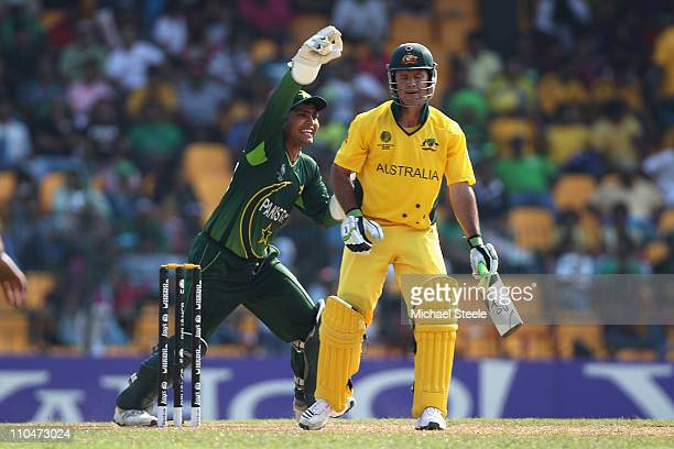 Ricky Ponting of Australia is caught behind by Kamran Akmal off the bowling of Mohammad Hafeez during the 2011 ICC World Cup Group A match between...