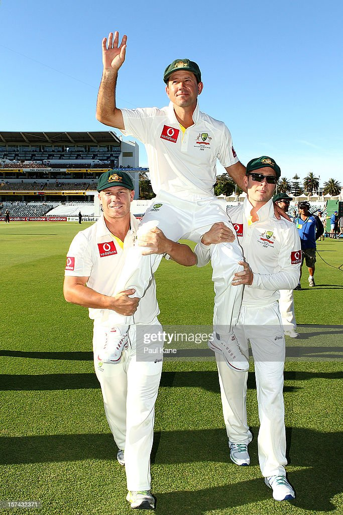 <a gi-track='captionPersonalityLinkClicked' href=/galleries/search?phrase=Ricky+Ponting&family=editorial&specificpeople=176564 ng-click='$event.stopPropagation()'>Ricky Ponting</a> of Australia is chaired from the ground by David Warner and Michael Clarke after retiring from International cricket during day four of the Third Test Match between Australia and South Africa at WACA on December 3, 2012 in Perth, Australia.