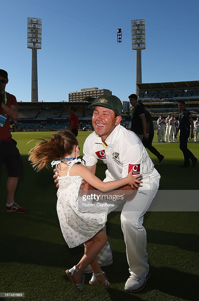 Ricky Ponting of Australia is greeted by his daughter Emmy after day four of the Third Test Match between Australia and South Africa at WACA on December 3, 2012 in Perth, Australia.