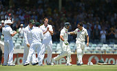 Ricky Ponting of Australia is greeting to the wicket by Ed Cowan and a guard of honour by the South African players during day four of the Third Test...