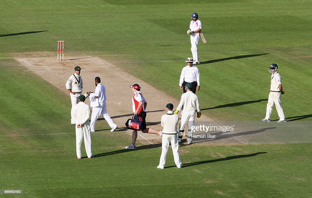 Ricky Ponting of Australia talks to 12th man Bilal Shafayat as physio Steve McCaig leaves the pitch during day five of the npower 1st Ashes Test Match between England and Australia at the SWALEC Stadium on July 12, 2009 in Cardiff, Wales.