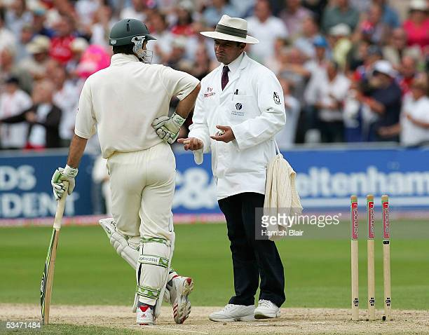 Ricky Ponting of Australia talks to umpire Aleem Dar while waiting for the third umpire after being run out during day three of the Fourth npower...