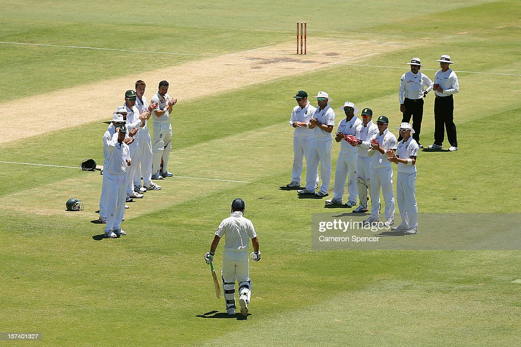 Ricky Ponting of Australia walks through a South African player guard of honour as he heads onto the field to bat during day four of the Third Test Match between Australia and South Africa at WACA on December 3, 2012 in Perth, Australia.