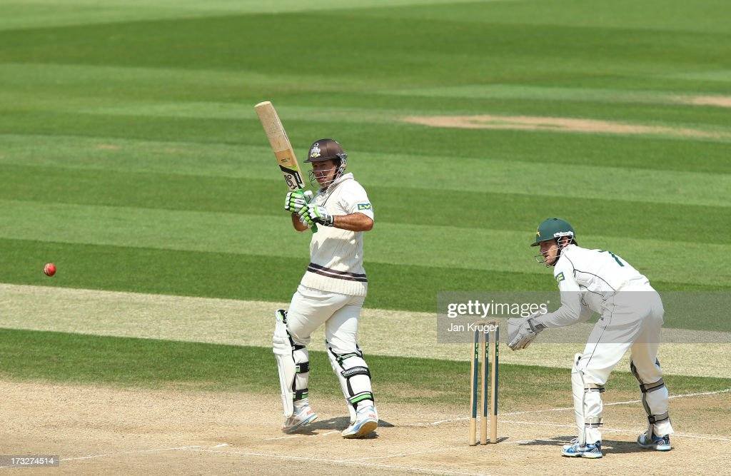 <a gi-track='captionPersonalityLinkClicked' href=/galleries/search?phrase=Ricky+Ponting&family=editorial&specificpeople=176564 ng-click='$event.stopPropagation()'>Ricky Ponting</a> of Surrey clips a ball off his legs with Chris Read of Nottinghamshire looking on during the LV County Championship match between Surrey and Nottinghamshire at The Kia Oval on July 11, 2013 in London, England.
