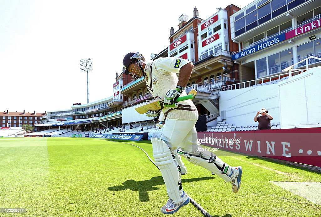 Ricky Ponting of Surrey makes his way out to bat for the last time in his first class career during the LV County Championship match between Surrey and Nottinghamshire at The Kia Oval on July 11, 2013 in London, England.