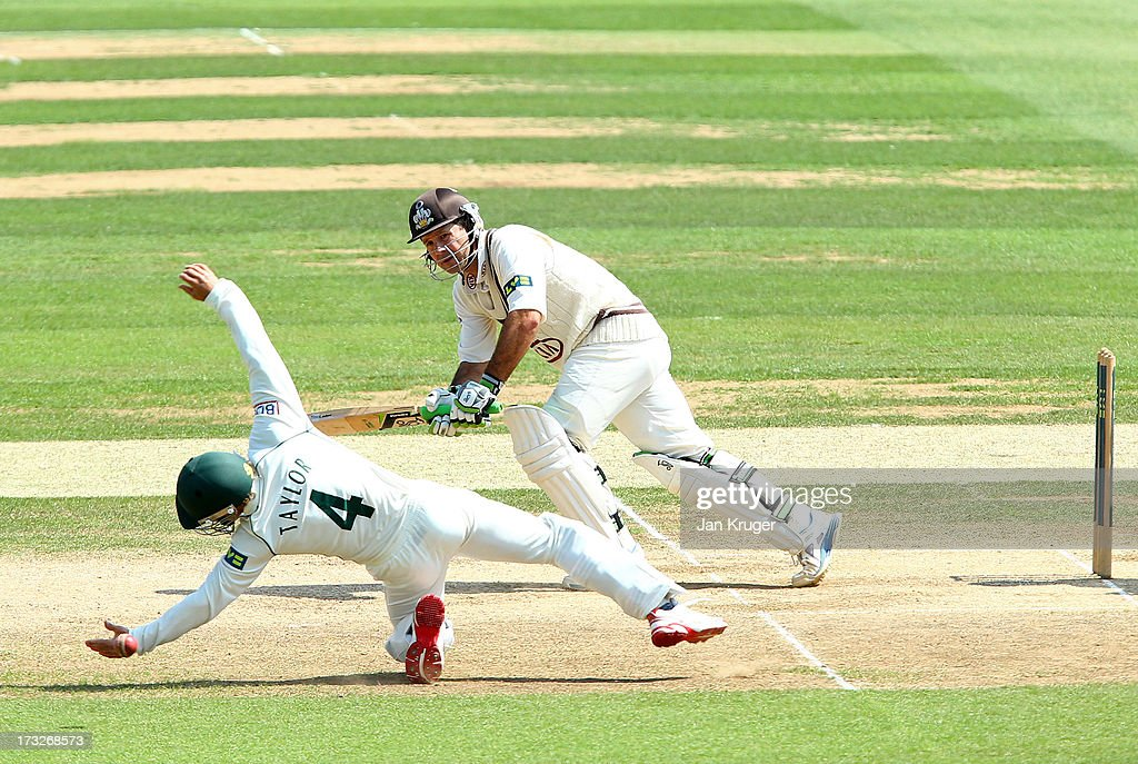 Ricky Ponting of Surrey sees James Taylor of Nottinghamshire come close to a catch as he plays the ball to mid-wicket during the LV County Championship match between Surrey and Nottinghamshire at The Kia Oval on July 11, 2013 in London, England.