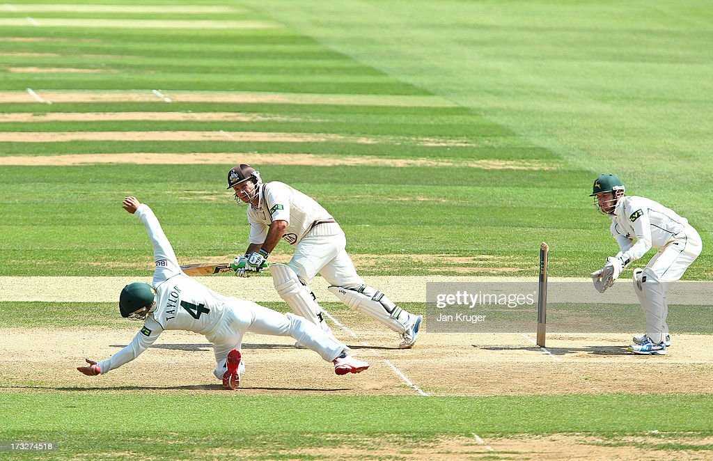 <a gi-track='captionPersonalityLinkClicked' href=/galleries/search?phrase=Ricky+Ponting&family=editorial&specificpeople=176564 ng-click='$event.stopPropagation()'>Ricky Ponting</a> of Surrey sees James Taylor of Nottinghamshire come close to a catch as he plays the ball to mid-wicket during the LV County Championship match between Surrey and Nottinghamshire at The Kia Oval on July 11, 2013 in London, England.