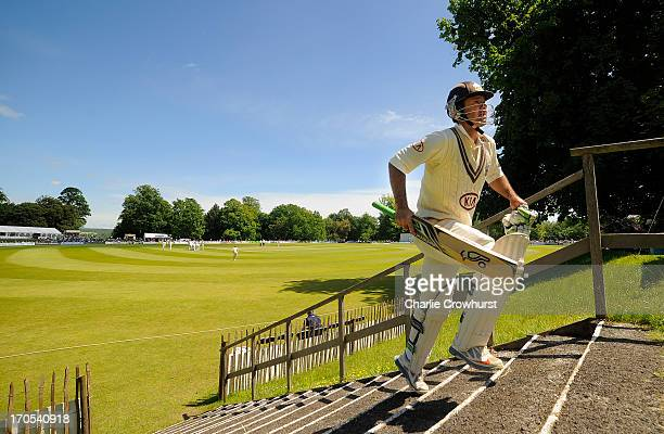Ricky Ponting of Surrey walks back to the pavilion dejected after being caught behind by Sussex's Chris Jordan for 13 during day three of the LV...