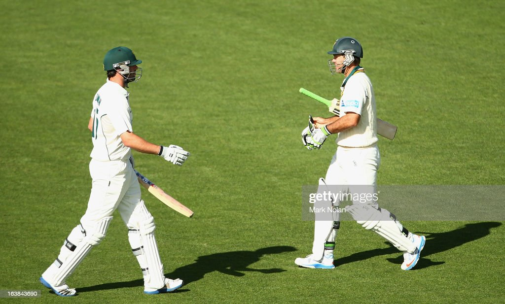 Ricky Ponting of Tasmania (R) walks onto the field after the dismissal of Alex Doolan (L) during day four of the Sheffield Shield match between the Tasmania Tigers and the Victoria Bushrangers at Blundstone Arena on March 17, 2013 in Hobart, Australia.
