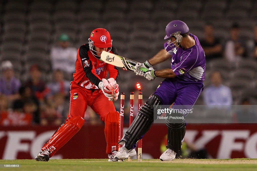 <a gi-track='captionPersonalityLinkClicked' href=/galleries/search?phrase=Ricky+Ponting&family=editorial&specificpeople=176564 ng-click='$event.stopPropagation()'>Ricky Ponting</a> of the Hurricanes is bowled by Muttiah Muralitharan of the Renegades during the Big Bash League match between the Melbourne Renegades and the Hobart Hurricanes at Etihad Stadium on December 19, 2012 in Melbourne, Australia.