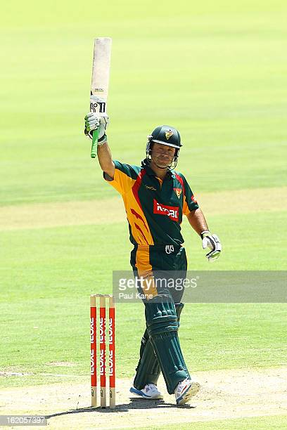 Ricky Ponting of the Tigers celebrates his half century during the Ryobi One Day Cup match between the Western Australia Warriors and the Tasmanian...