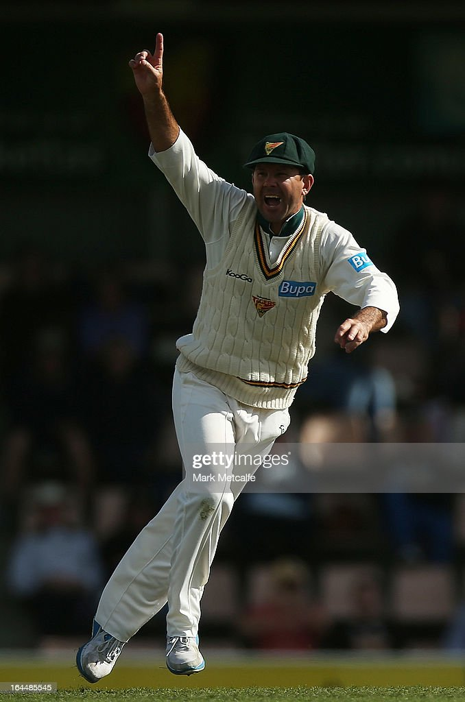 Ricky Ponting of the Tigers celebrates the dismissal of Nathan Reardon of the Bulls by Evan Gulbis of the Tigers during day three of the Sheffield Shield final between the Tasmania Tigers and the Queensland Bulls at Blundstone Arena on March 24, 2013 in Hobart, Australia.
