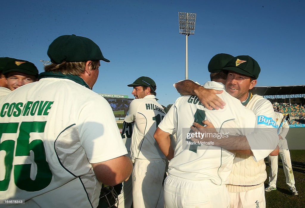 <a gi-track='captionPersonalityLinkClicked' href=/galleries/search?phrase=Ricky+Ponting&family=editorial&specificpeople=176564 ng-click='$event.stopPropagation()'>Ricky Ponting</a> of the Tigers celebrates with teammates Evan Gulbis and <a gi-track='captionPersonalityLinkClicked' href=/galleries/search?phrase=Mark+Cosgrove&family=editorial&specificpeople=227329 ng-click='$event.stopPropagation()'>Mark Cosgrove</a> after victory in the Sheffield Shield final between the Tasmania Tigers and the Queensland Bulls at Blundstone Arena on March 26, 2013 in Hobart, Australia.