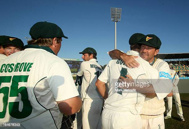Ricky Ponting of the Tigers celebrates with teammates Evan Gulbis and Mark Cosgrove after victory in the Sheffield Shield final between the Tasmania...