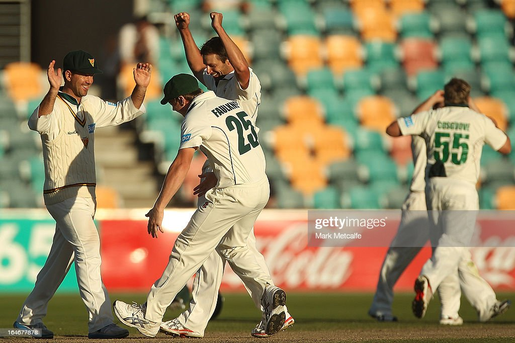 <a gi-track='captionPersonalityLinkClicked' href=/galleries/search?phrase=Ricky+Ponting&family=editorial&specificpeople=176564 ng-click='$event.stopPropagation()'>Ricky Ponting</a> of the Tigers celebrates with teammates James Faulkner and <a gi-track='captionPersonalityLinkClicked' href=/galleries/search?phrase=Ben+Hilfenhaus&family=editorial&specificpeople=762747 ng-click='$event.stopPropagation()'>Ben Hilfenhaus</a> after victory in the Sheffield Shield final between the Tasmania Tigers and the Queensland Bulls at Blundstone Arena on March 26, 2013 in Hobart, Australia.