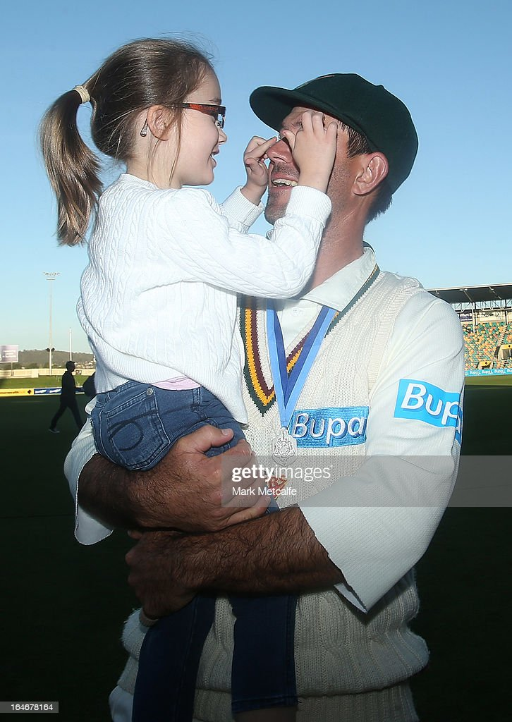 Ricky Ponting of the Tigers holds his daughter Emmy after victory in the Sheffield Shield final between the Tasmania Tigers and the Queensland Bulls at Blundstone Arena on March 26, 2013 in Hobart, Australia.