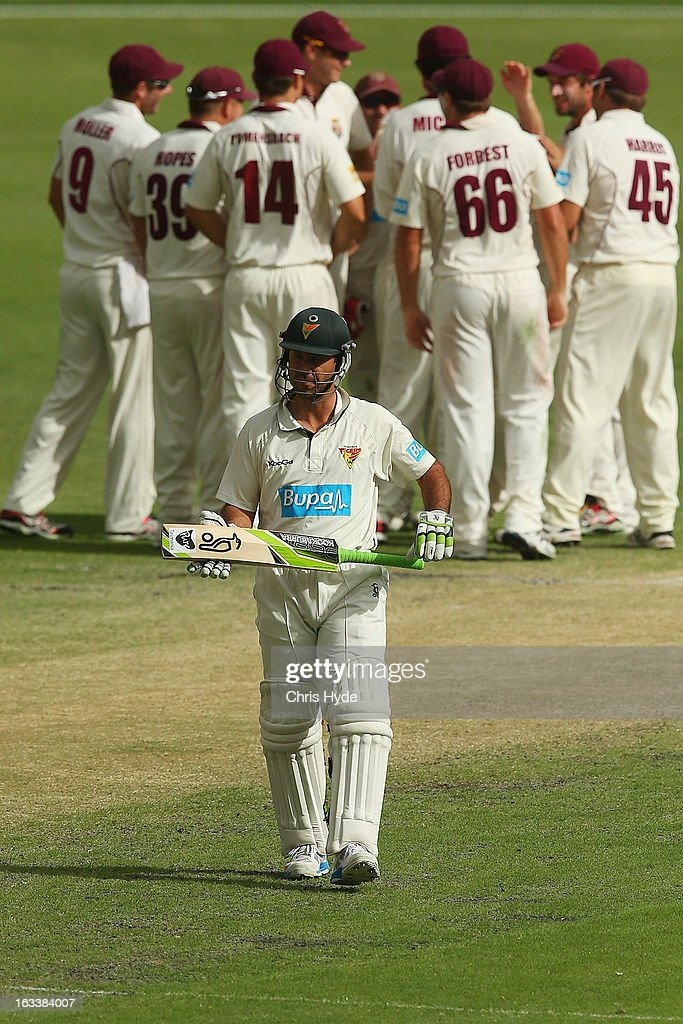 <a gi-track='captionPersonalityLinkClicked' href=/galleries/search?phrase=Ricky+Ponting&family=editorial&specificpeople=176564 ng-click='$event.stopPropagation()'>Ricky Ponting</a> of the Tigers is bowled out for a duck by Nathan Reardon of the Bulls during day three of the Sheffield Shield match between the Queensland Bulls and the Tasmanian Tigers at The Gabba on March 9, 2013 in Brisbane, Australia.
