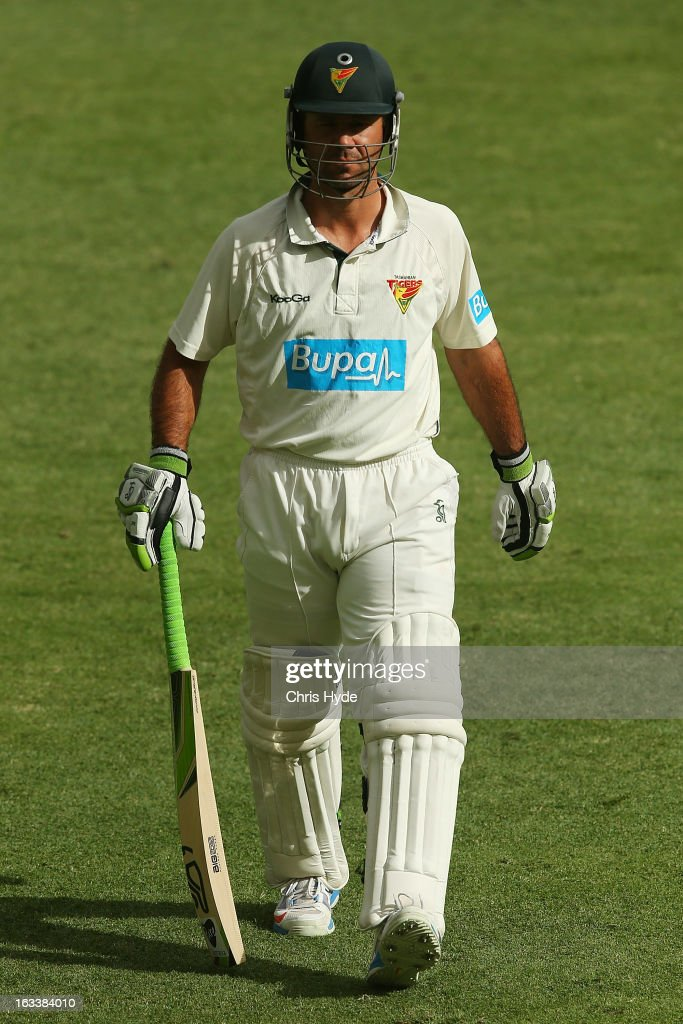 Ricky Ponting of the Tigers is bowled out for a duck by Nathan Reardon of the Bulls during day three of the Sheffield Shield match between the Queensland Bulls and the Tasmanian Tigers at The Gabba on March 9, 2013 in Brisbane, Australia.