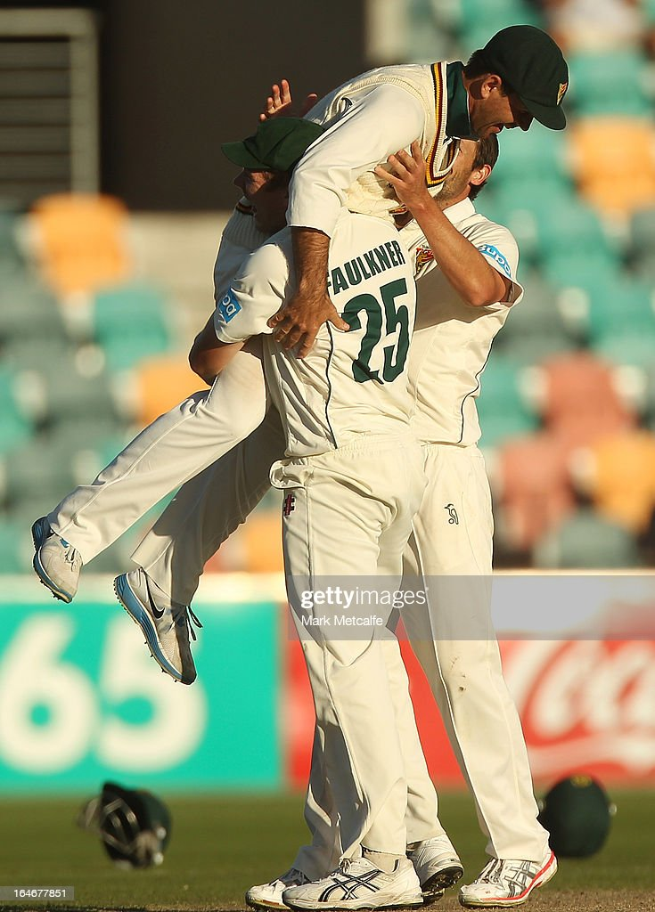<a gi-track='captionPersonalityLinkClicked' href=/galleries/search?phrase=Ricky+Ponting&family=editorial&specificpeople=176564 ng-click='$event.stopPropagation()'>Ricky Ponting</a> of the Tigers is picked up by teammates James Faulkner and <a gi-track='captionPersonalityLinkClicked' href=/galleries/search?phrase=Ben+Hilfenhaus&family=editorial&specificpeople=762747 ng-click='$event.stopPropagation()'>Ben Hilfenhaus</a> in celebration of victory in the Sheffield Shield final between the Tasmania Tigers and the Queensland Bulls at Blundstone Arena on March 26, 2013 in Hobart, Australia.