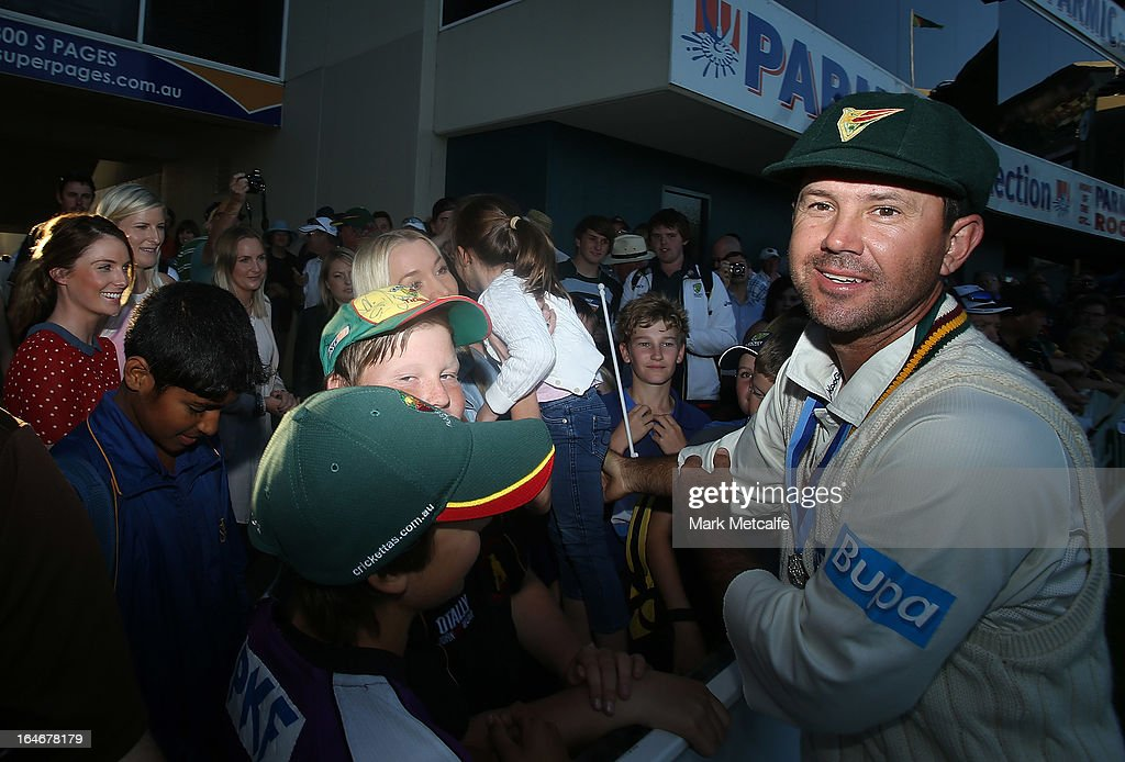 Ricky Ponting of the Tigers passes his daughter Emmy to his wife Rianna after victory in the Sheffield Shield final between the Tasmania Tigers and the Queensland Bulls at Blundstone Arena on March 26, 2013 in Hobart, Australia.