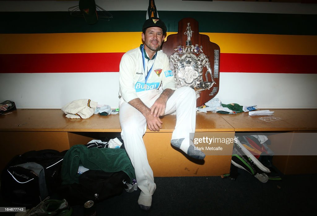 <a gi-track='captionPersonalityLinkClicked' href=/galleries/search?phrase=Ricky+Ponting&family=editorial&specificpeople=176564 ng-click='$event.stopPropagation()'>Ricky Ponting</a> of the Tigers poses with the Sheffield Shield trophy after winning the Sheffield Shield final between the Tasmania Tigers and the Queensland Bulls at Blundstone Arena on March 26, 2013 in Hobart, Australia.