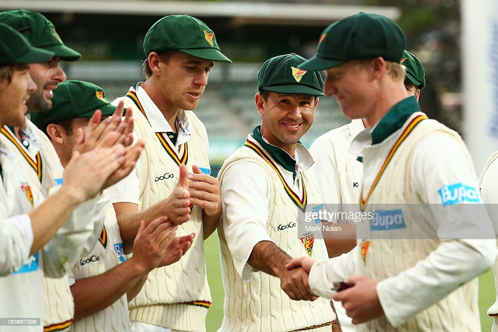 Ricky Ponting of the Tigers shakes the hand of man of the match Jordan Silk during day four of the Sheffield Shield match between the Tasmania Tigers and the Victoria Bushrangers at Blundstone Arena on March 17, 2013 in Hobart, Australia.